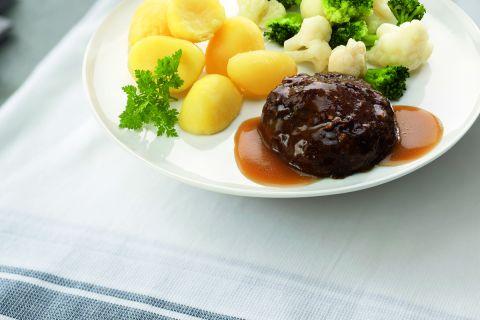 Gehaktbal in jus met bloemkool, broccoli en gekookte aardappelen