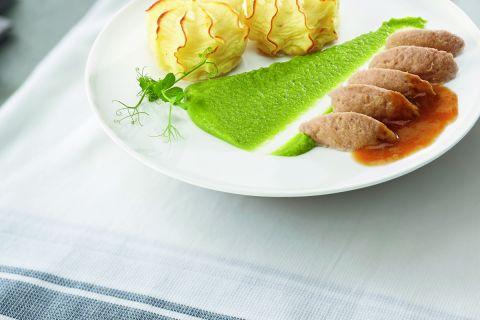 Varkensvlees met doperwten en aardappelpuree (op=op)
