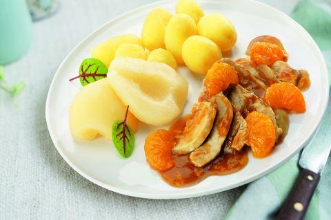 Kalkoenfilet in sinaasappelsaus met halve peertjes en gekookte krieltjes