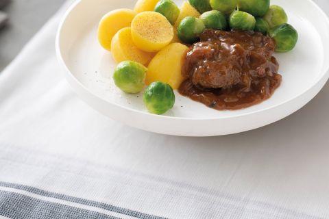 Karbonade (zonder been) met spruitjes en gekookte aardappelen